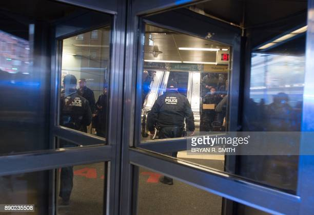 Port Authority Police watch as people evacuate after a reported explosion at the Port Authority Bus Terminal on December 11 2017 in New York New York...