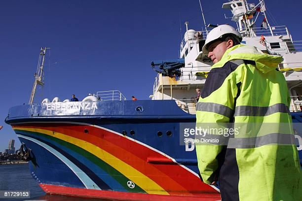 A port authority worker keeps watch as the Greenpeace ship'Esperanza' cruises into Sydney Harbour on June 27 2008 in Sydney Australia The Esperanza...