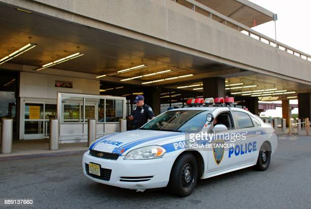 A Port Autority police officer stands guard outside the terminal A at the Newark Liberty Airport after authorities ordered a partial evacuation May...