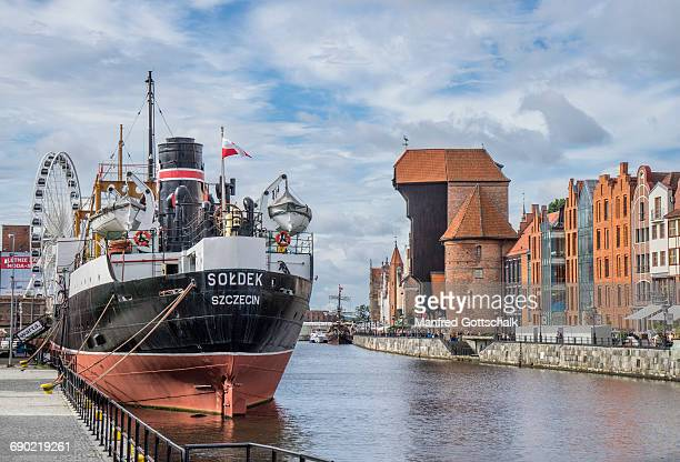port crane and museum ship soldek - motlawa river stock pictures, royalty-free photos & images