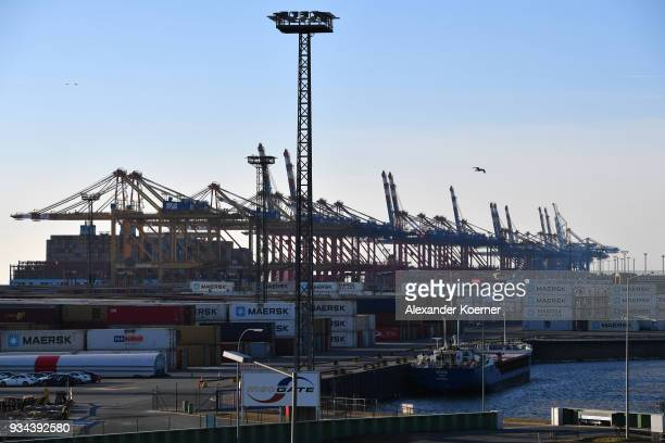 Port cranes stand at Bremerhaven port on March 19 2018 in Bremerhaven Germany The new German government is seeking to prevent new tariffs between the...