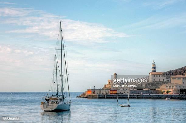 Port de Soller bay lighthouse, boat and birds