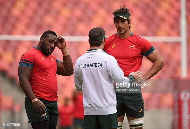 Port Elizabeth South Africa 21 June 2016 Tendai Mtawarira left and Eben Etzebeth of South Africa with assistant coach Johann van Graan during squad...