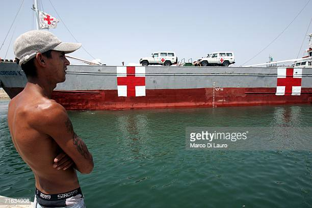 A port employee watches as International Committee of the Red Cross ship Georgios K docks at the city port on August 12 2006 in Tyre Southern Lebanon...