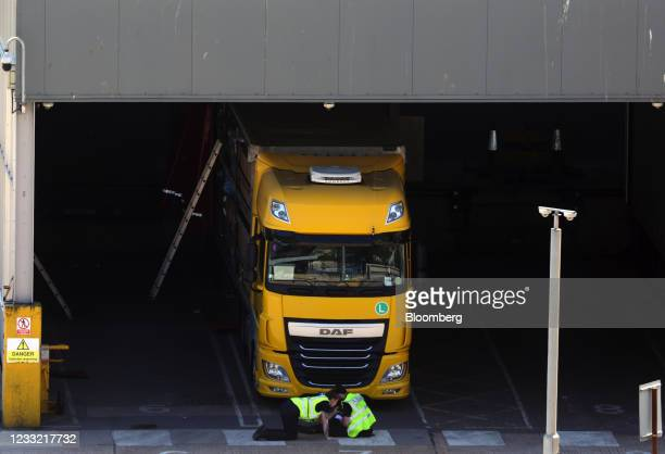 Port employees check the underside of a haulage truck at the freight check-in area at the Port of Dover Ltd. In Dover, U.K., on Tuesday, June 1,...