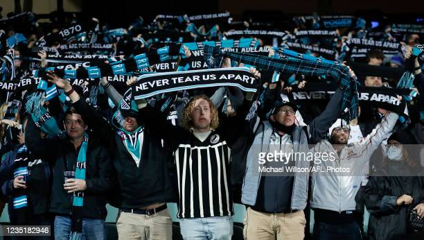 Port fans are seen during the 2021 AFL Second Preliminary Final match between the Port Adelaide Power and the Western Bulldogs at Adelaide Oval on...