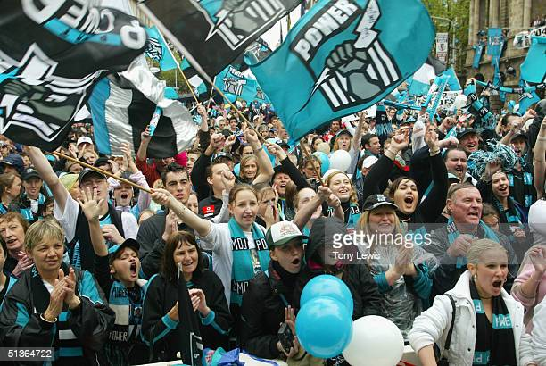 Port fans cheer their team during the tickertape parade for AFL Premiers Port Adelaide Power in King William Street September 28 2004 in Adelaide...