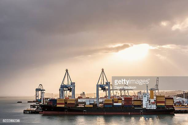 port freight terminals at sunrise in auckland, north island, new zealand - auckland stock pictures, royalty-free photos & images