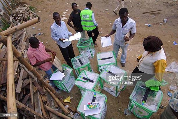 Election officials from the Independent National Electoral Commission check ballot boxes at a centre 14 April 2007 in Port Harcourt Nigerians went to...