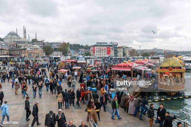 port in galata bridge, behind the süleymaniye mosque, istanbul - pavliha stock photos and pictures