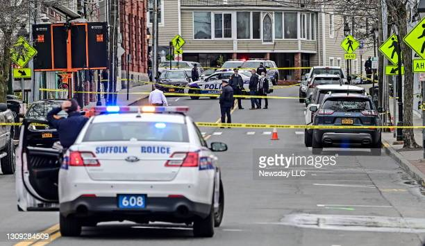 Suffolk County Police operate at the scene of a reported shooting on Main Street in Port Jefferson, New York on the afternoon of March 24, 2021.