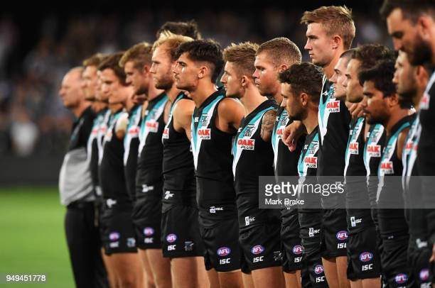Port lineup during the playing of the Last Post during the round five AFL match between the Port Adelaide Power and the Geelong Cats at Adelaide Oval...