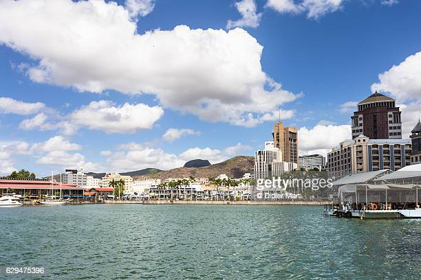 port louis cityscape and harbor in mauritius - port louis stock photos and pictures