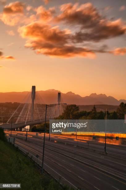 port mann bridge at sunset, bc, canada - surrey british columbia stock photos and pictures