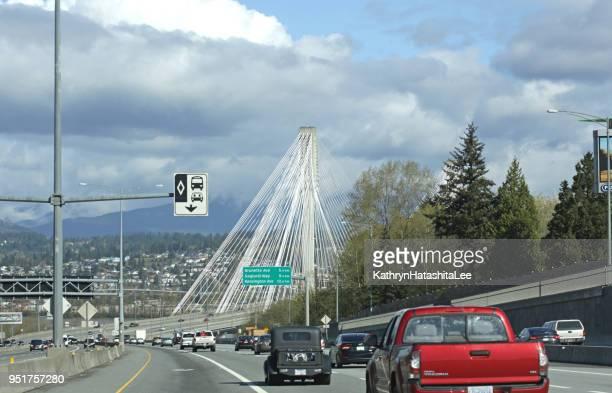 port mann bridge traffic in surrey, canada - surrey british columbia stock photos and pictures