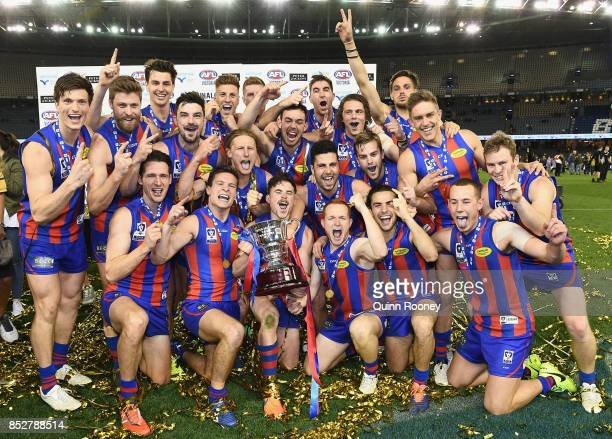 Port Melbourne pose with the Premiership Cup after winning the VFL Grand Final match between Richmond and Port Melbourne at Etihad Stadium on...