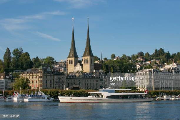 port of lucerne and church of st. leodegar. - spire stock pictures, royalty-free photos & images