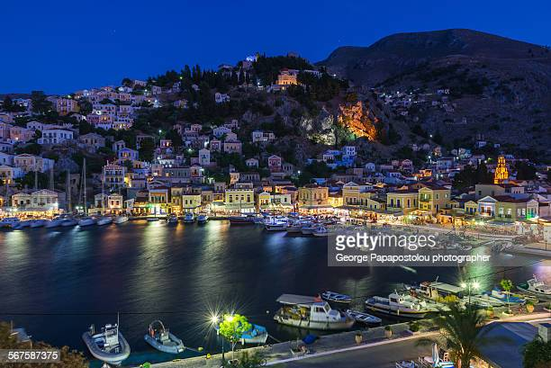 port of symi island at night - symi stock photos and pictures