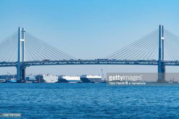 port of yokohama and yokohama bay bridge in yokohama in kanagawa prefecture in japan - kanagawa prefecture stock pictures, royalty-free photos & images
