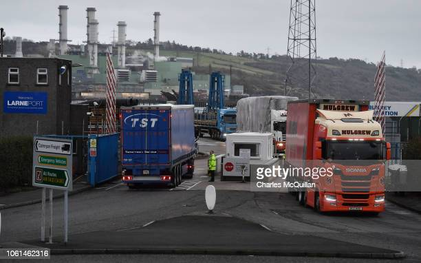 Port officers inspect vehicles at a harbour checkpoint on November 14, 2018 in Larne, Northern Ireland. Prime Minister Theresa May is locked in talks...