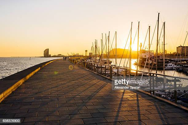 port olimpic at sunset, barcelona, spain - la barceloneta stock pictures, royalty-free photos & images