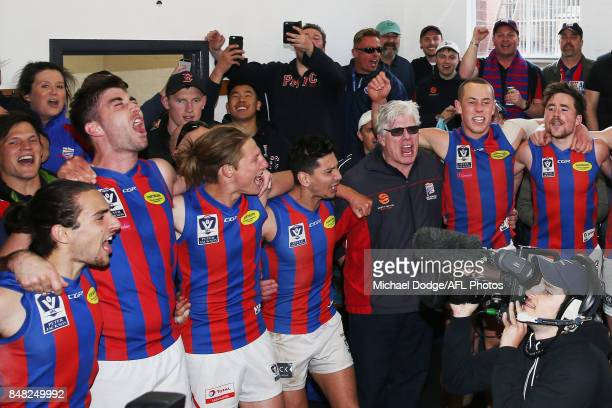Port players coach Gary Ayres sing the club song after winning during the VFL Preliminary Final match between Williamstown and Port Melbourne at...