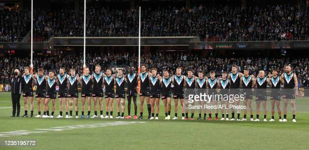 Port players line up for the National Anthem during the 2021 AFL Second Preliminary Final match between the Port Adelaide Power and the Western...