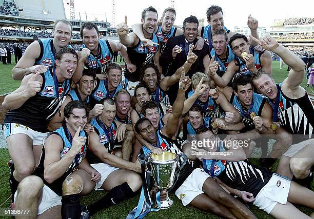 Port Power celebrate with the cup after the AFL Grand Final between the Brisbane Lions and Port Adelaide Power at the Melbourne Cricket Ground...