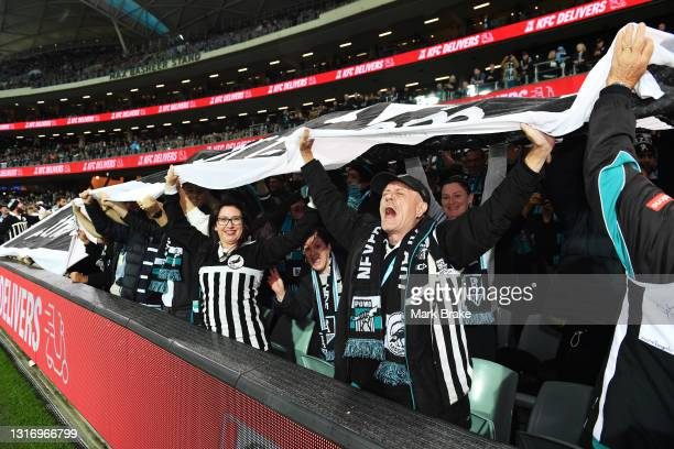 Port Power supporters hold up a huge banner before the round eight AFL match between the Port Adelaide Power and the Adelaide Crows at Adelaide Oval...