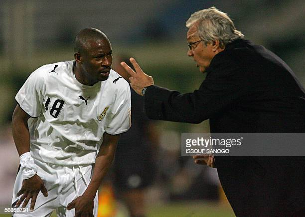 Ghanaian team coach Ratomir Dujkovic from Serbia gives instructions to Abubakari Yakubu during the knockout round game between Ghana's Black Stars...