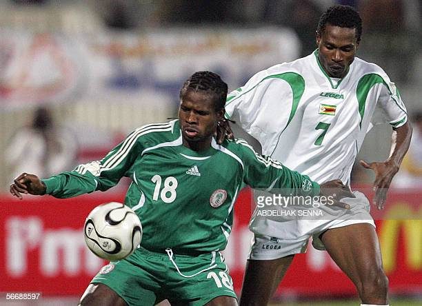 Nigerian Christian Obodo , shields the ball from Zimbabwean Joel Lupahla during the knock-out round game between Nigeria and Zimbabwe in the group D...