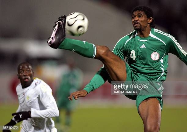 Nigerian Nwankwo Kanu vies with Senegal's Souleymane Diawara during their knockout round game in the Group D of the African Nations Cup preliminary...
