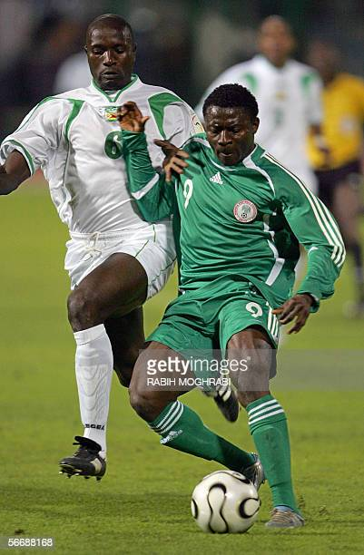 Nigerian Obafemi Martins shields the ball from Zimbabwe's Zvenyika Makonese during their preliminary round African Nations Cup Group D football match...