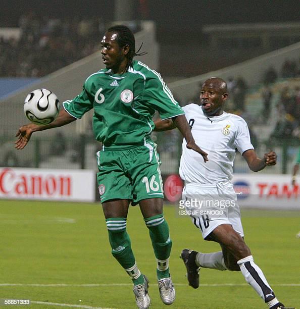 Nigerian player Joseph Enakarhire vies with Ghanaian player Abubakari Yakubu during their African Nations Cup football match at alMasri club stadium...