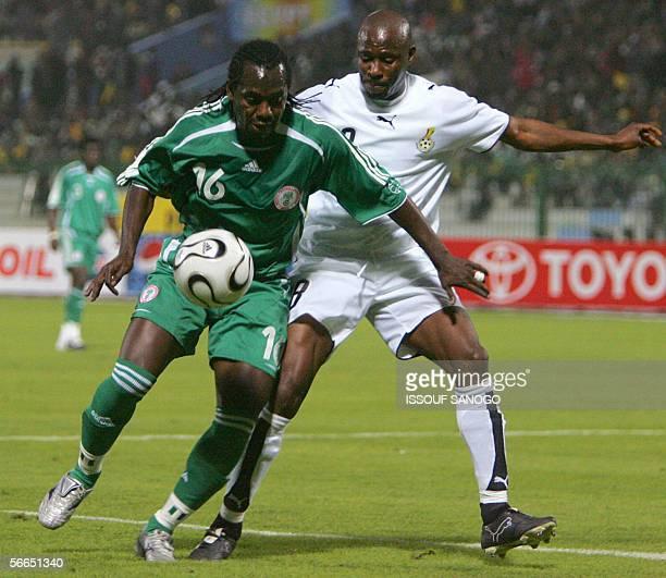 Nigerian player Joseph Enakarhire vies with Ghanaian player Abubakari Yakubu during African Nations Cup football match at alMasri club stadium in...