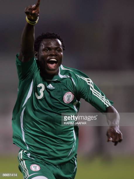Nigerian player Taye Taiwo jubilates after scoring the first goal against Ghana during their African Nations Cup football match at AlMasri club...