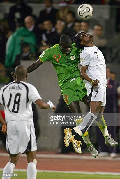 Senegalese Amdy Mustafa Faye player for Newcastle England jumps for the ball with Ghana's Laryea Kingston while Abubakari Yakubu watches during the...