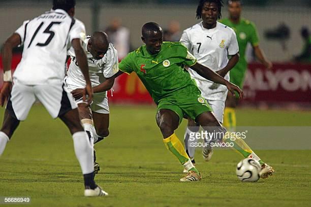 Senegalese Souleymahe Diawara player in Sochaux dribbles the ball past Ghanaian players John Pantsil Abubakari Yakubu and Laryea Kingston during the...