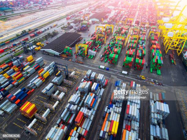 Port shipping Use crane lifting containers in ship break-bulk carrier by sea of Thailand .