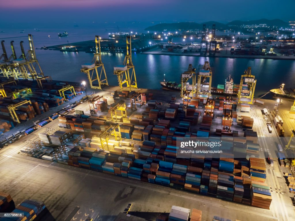 Port shipping Use crane lifting containers in ship break-bulk carrier by sea at Night of Thailand . : Stock Photo