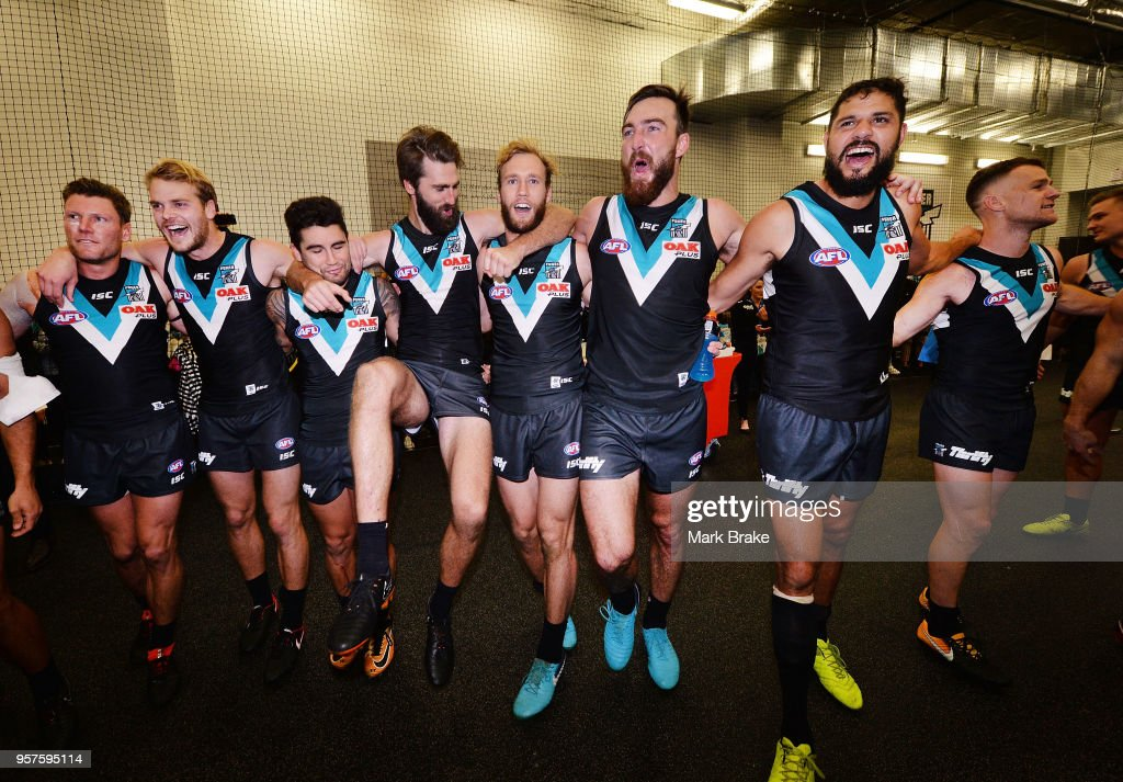 Port sing the club song after defeating the Crows during the round eight AFL match between the Port Adelaide Power and the Adelaide Crows at Adelaide Oval on May 12, 2018 in Adelaide, Australia.