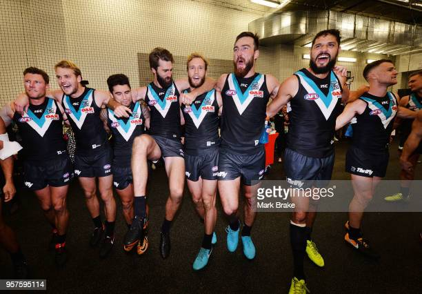 Port sing the club song after defeating the Crows during the round eight AFL match between the Port Adelaide Power and the Adelaide Crows at Adelaide...