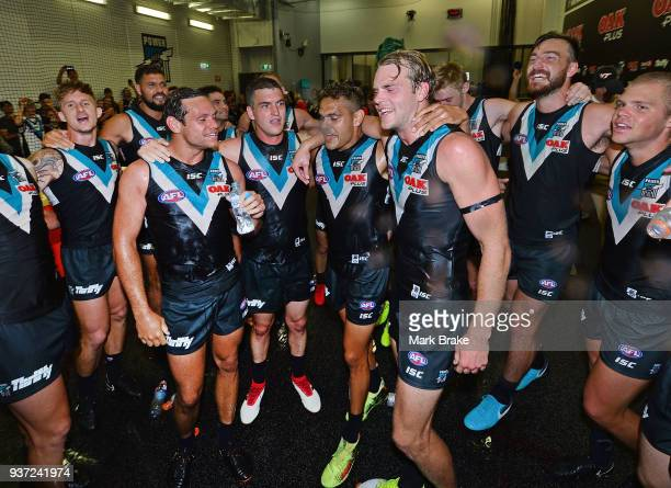 Port sing the song and drown new players Steven Motlop Tom Rockliff Dom Barry and Jack Watts of Port Adelaide during the round one AFL match between...