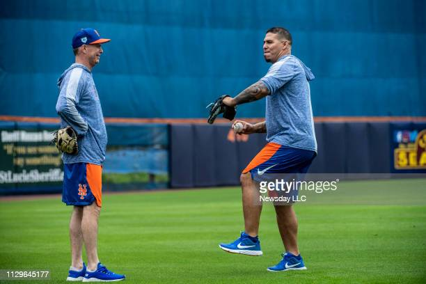 New York Mets first base coach Glenn Sherlock and catcher Wilson Ramos on February 13 2019 during a spring training workout in Port St Lucie Florida