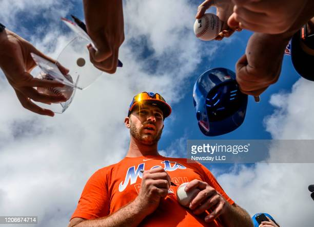 New York Mets infielder Pete Alonso signs autographs during a spring training workout on Saturday Feb 15 in Port St Lucie Florida