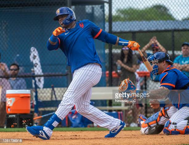 New York Mets outfielder Yoenis Cespedes takes on live batting practice during a spring training workout on February 19, 2020 at Clover Park in Port...