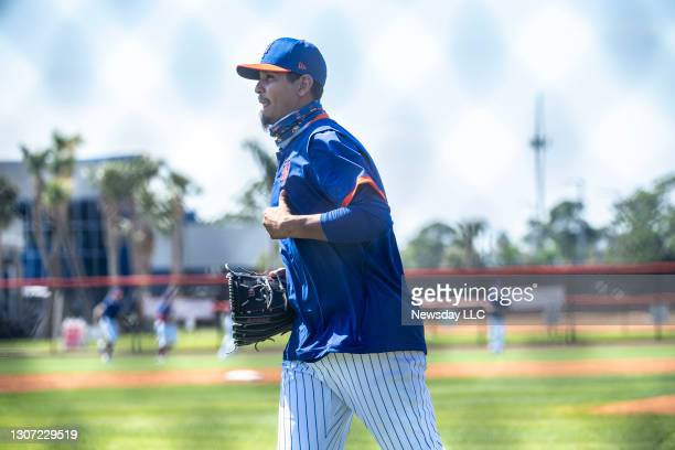New York Mets pitcher Carlos Carrasco jogs during a spring training workout on Feb. 26, 2021 in Port St. Lucie, Florida.