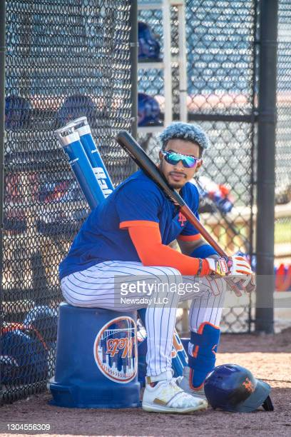 New York Mets player Francisco Lindor sits holding a bat during a spring training workout on Feb. 26 in Port St. Lucie, Florida.