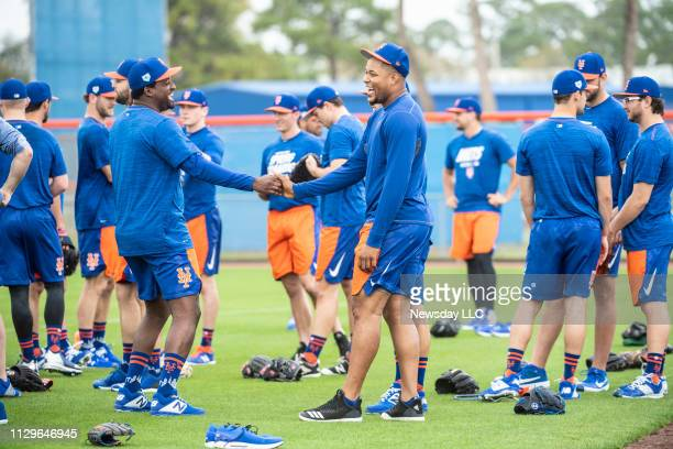 New York Mets player Jeurys Familia is greeted by teammates at the start of a spring training workout on February 11, 2019 at First Data Field in...