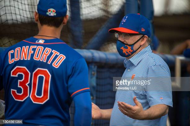 New York Mets player Michael Conforto and Mets owner Steve Cohen chat during a spring training workout on Feb. 27 in Port St. Lucie, Florida. Photo...